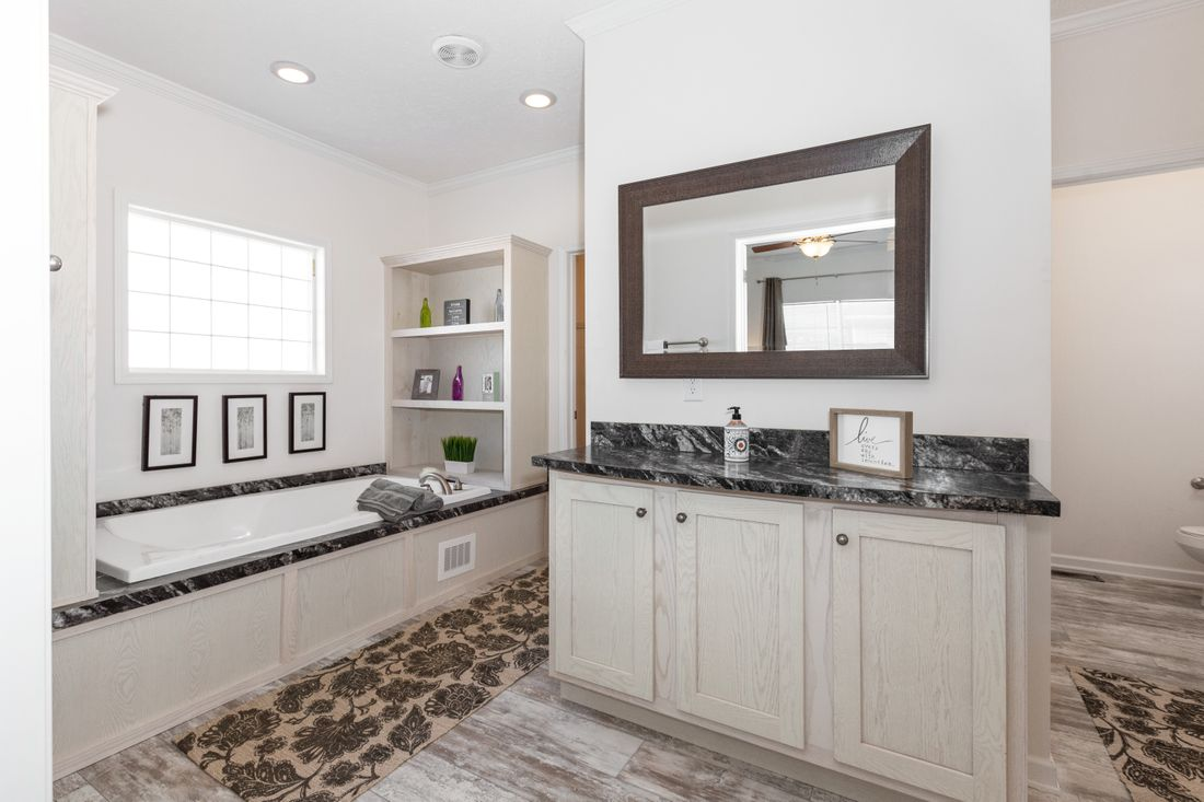 The 2095 HERITAGE Master Bathroom. This Manufactured Mobile Home features 3 bedrooms and 2 baths.