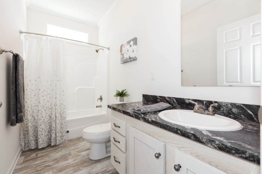 The 2095 HERITAGE Guest Bathroom. This Manufactured Mobile Home features 3 bedrooms and 2 baths.