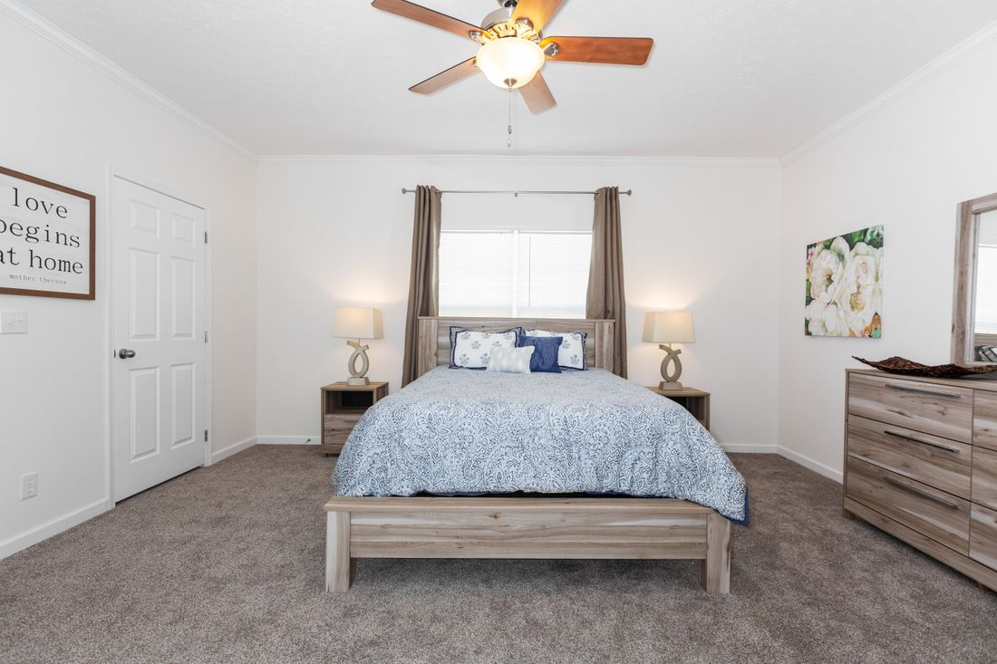 The 2095 HERITAGE Master Bedroom. This Manufactured Mobile Home features 3 bedrooms and 2 baths.