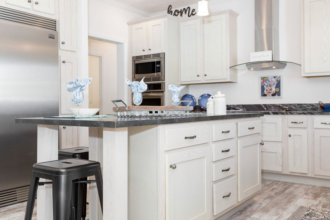 The 2095 HERITAGE Kitchen. This Manufactured Mobile Home features 3 bedrooms and 2 baths.