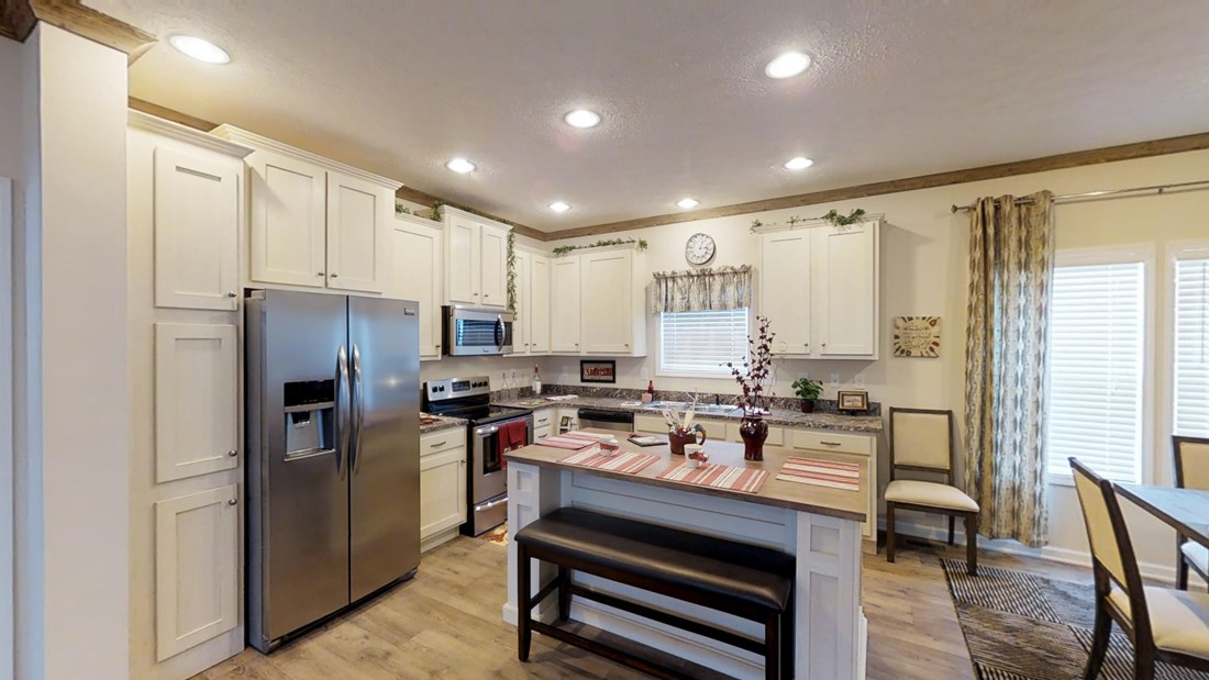 The 2917 HERITAGE Kitchen. This Manufactured Mobile Home features 4 bedrooms and 2 baths.