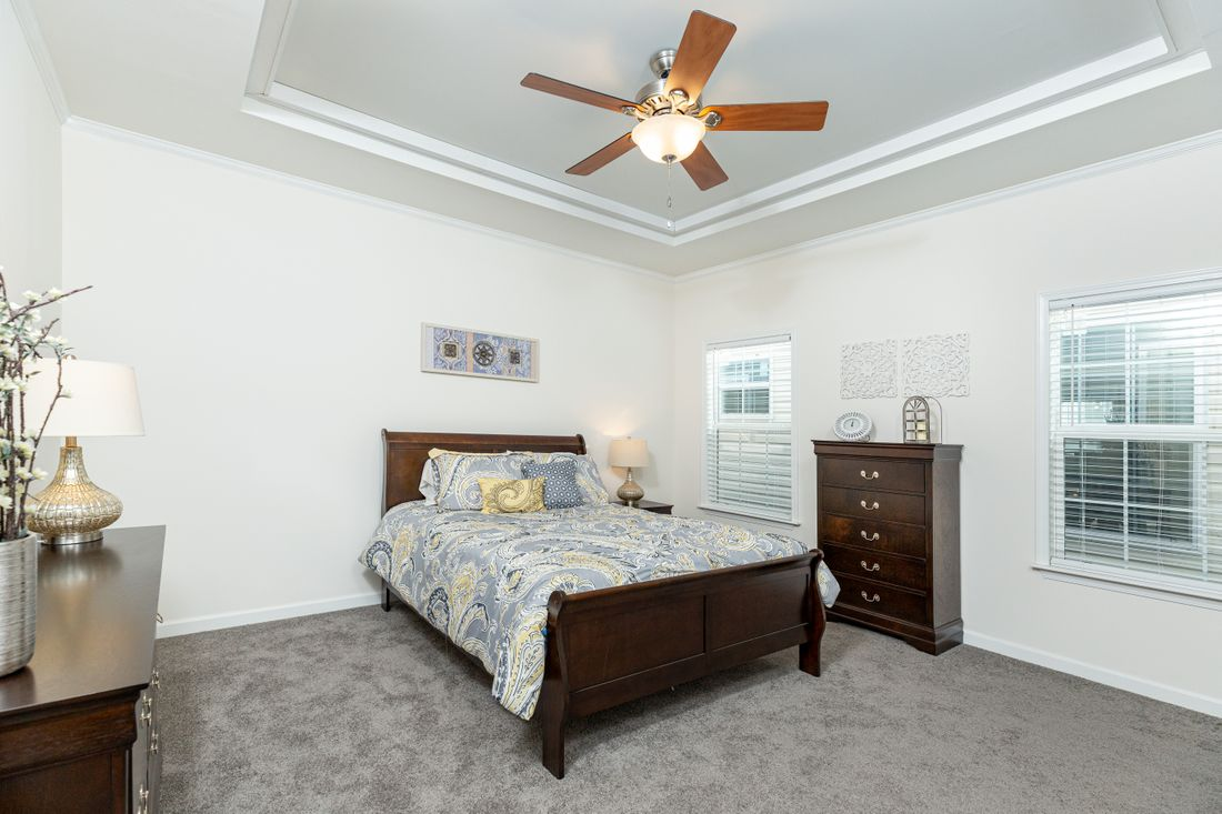 The 1714 HERITAGE Master Bedroom. This Manufactured Mobile Home features 3 bedrooms and 2 baths.