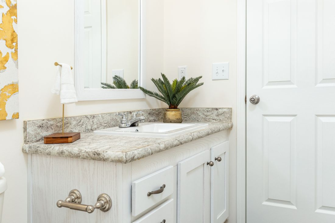 The 1714 HERITAGE Guest Bathroom. This Manufactured Mobile Home features 3 bedrooms and 2 baths.
